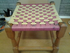 Vintage old wooden footstool with woven seat