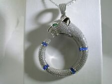 PANTHER PENDANT WITH  SAPPHIRE BAGUETTES AND EMERALD EYES IN STERLING SILVER
