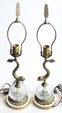 A Pair of Vintage Brass Dolphin Form Lamps with Glass Fonts, Rewired