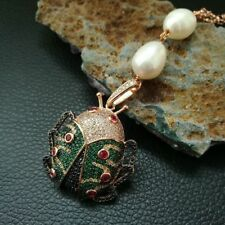 """M011806 22"""" White Rice Pearl Necklace BeetleCZPave Pendant"""