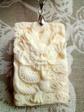 Lovely carved dragon amulet pendant. Free P&P