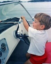 John F. Kennedy Jr. at the wheel of a speedboat August 1963 New 8x10 Photo