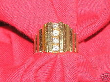 14KT YELLOW GOLD AND 4 DIAMOND CHANNEL SETTING RING .75 PTS RETAIL $1,800 1994
