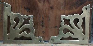 A Pair Of Old Reclaimed Brass Corner Decorative Fitments.