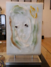 Sculpted stone plaque, female facial image in high/low relief. Signed. On Silve