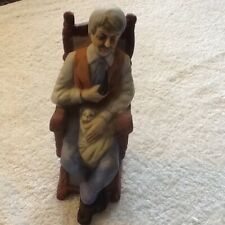 Brand unknown, Old man in chair holding dog and pipe.very nice collectible