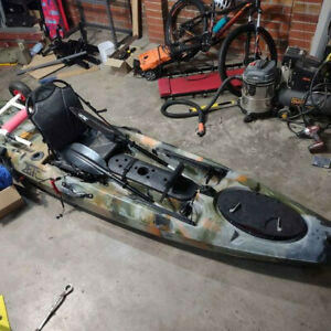 12ft Jet Ocean Fishing kayak with fish finder and other accessories.