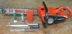 older Homelite 150 automatic chainsaw w/ accessories and owner's manual