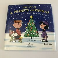 """The Joy of a Peanuts Christmas 50 Years of Holiday Comics"" Hallmark Books 2000"