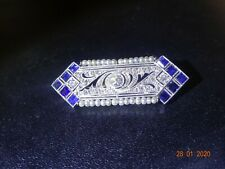 Beautiful diamond and sapphire brooch on platinum with seed pearls