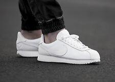 white nike cortez trainers