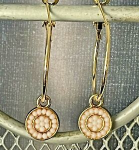 White Beads and Gold Hoop Earrings.
