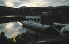 Houseboat docked as dusk falls, Waterway Houseboats Ltd., Sicamous, B.C. 40s-60s