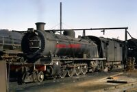 PHOTO  SOUTH AFRICAN RAILWAYS -   A CLASS 12R 4-8-2 ON SHED AT SPRINGS 1972