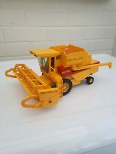 BRITAINS FARM TOYS NEW HOLLAND TR85 COMBINE HARVESTER