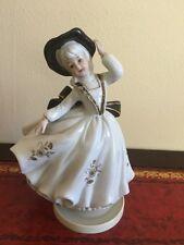 Vintage porcelain girl music box