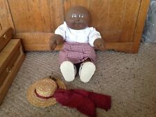 Vintage 1985 Afro American Cabbage Patch Doll.  Plastic head, no hair, brown eye