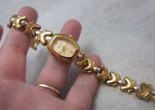 Vintage Oleg Cassini lady's wrist watch. two tone gold, silver