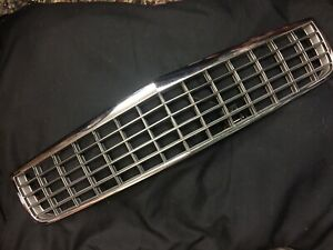 1994,1995,1996 Cadillac DeVille OEM chrome grille with opening release lever