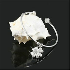 Silver tone flower charm open bracelet with crystal
