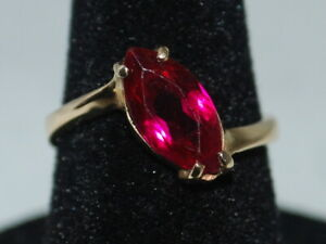 10k Yellow Gold Ring With A Solitaire Marquise Cut Ruby (July birthstone)