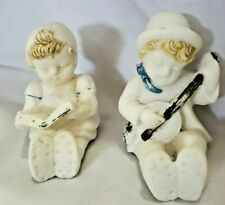 Vintage Chalkware Figurines - Boy with Banjo, Girl reading Book.
