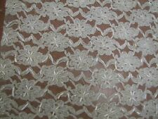 EXQUISITE HAND EMBROIDERY ON POLY LACE.