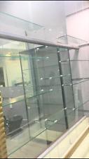 Suspended glass shelves