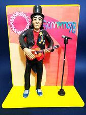 Statuina Action Figures Rino Gaetano con ukulele e sfondo Festival Sanremo 1978