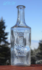 Scarce ROUND Owl Drug Co bottle BAY RUM w/ pic. of Great Horned OWL on front !