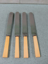 Four vintage Frank Wood Sheffield stainless steel faux bone handle knives