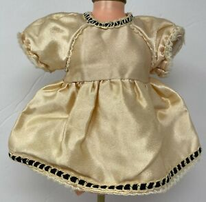 "Vintage Antique  Doll Peach Tan Dress With Black Trim 6 1/8"" Long"
