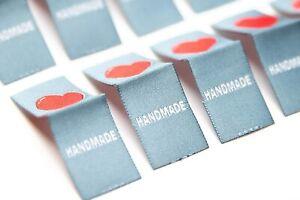 Set mit 10 ''Herz'' Textiletiketten mit Mittelfaltung aus Polyestergarnen als Au