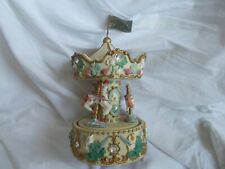 Three horse ornate musical carousel in fine working and physical condition