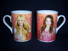 (2) official MILEY CYRUS HANNAH MONTANA ceramic mugs-SECRET STAR-2008 disney-NEW