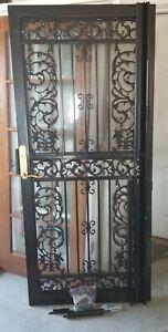 Grisham 114 Black Bird of Paradise Steel Security Door (36x80 inch) MSRP $1317
