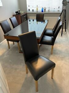 Harveys' black glass dining room table and 6 chairs