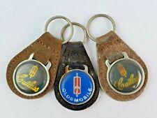Lot of 3 Vintage Oldsmobile Cutlass leather keychain keyring metal back