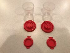 TUPPERWARE 2 SETS OF NEW MINI SALT AND PEPPER SHAKERS IN CLEAR BASE/RED SEAL