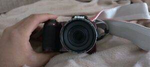 Nikon 16 Megapixel Digital Camera with Case Strap and 16 Gigabyte SD Card - Red