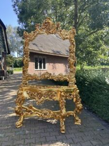 Baroque /Rococo console with mirror with marble top.