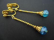 A PAIR OF  LONG SKY BLUE CRYSTAL TEARDROP  GOLD PLATED CLIP ON EARRINGS.