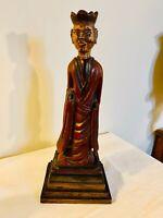 Dignitaire en bois sculpté polychrome - hauteur : 33,2 cm