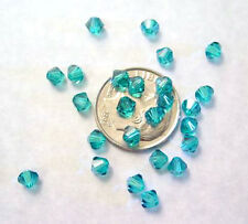 24 BLUE ZIRCON SWAROVSKI CRYSTAL 5328  BICONE BEADS 4MM
