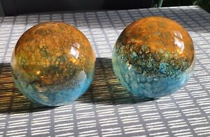 2 vintage mottled art glass globe decorations or lamp shades.