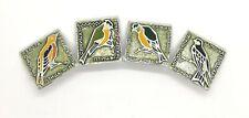 Birds. Set of 4 Soviet multi-colored pin badges.