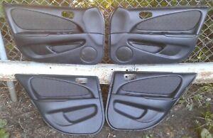 1998 1999 2000 2001 2002 Toyota Corolla S black door panel panels set OEM