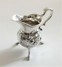 More details for antique white metal cream jug with embossed decoration