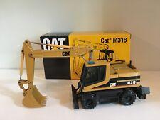 Caterpillar M 318 escavatore mobile di NZG 405 1:50 OVP