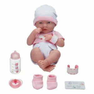 New Born Baby doll 14 in with accessories, takes a pacifier